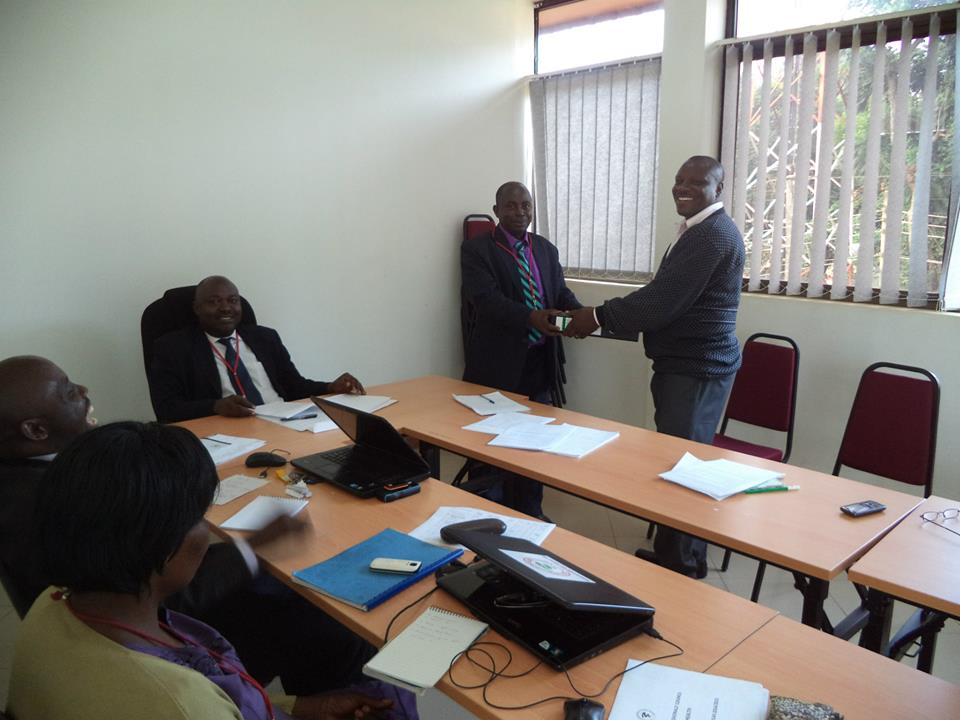 Former Head Of Inspection and Quality Assurance Dept officially hands over office to the incoming Deputy Registrar